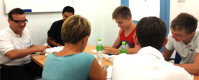 Western students learning Thai in one of our classrooms